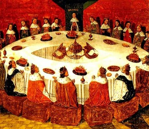 King Arthur and the Knights of the Round Table, painting by Michel Gantelet from 1472. Notice that in this case, the King (or the authority figure) has reduced their status to become a member of the group.