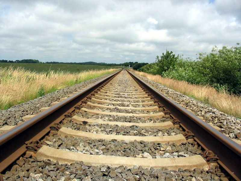 The rail road tracks symbolize the dual track process -- a method that will take you much further down the road.