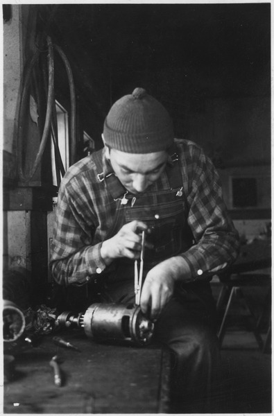 lossy-page1-395px-Man_working_on_a_machine_part_-_NARA_-_285475.tif