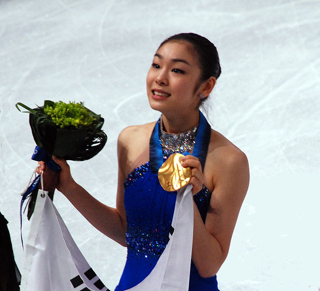 Yunnan Kim Showing her Gold medal for figure skating. Image by: amex